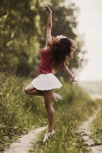 Girl dancing in the countryside