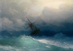 Sailing ship in heavy waves at sea